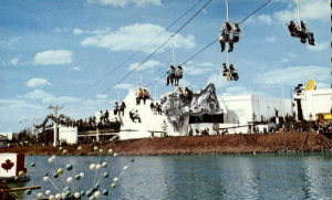 Postcard of event from CardCow.com. (This ride terrified 5-year-old me, since it combined heights and water.)